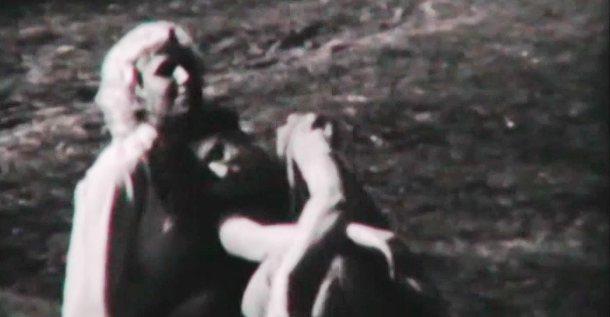 Still from the film «The Wonderful Years». Two-shot. Old black and white portrait of two smiling women, one hugging another. Both looking directly at the viewer.